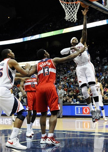 Korver, Hawks beat winless Wizards, 101-100 in OT