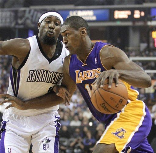 Kings upset listless Lakers, 113-97