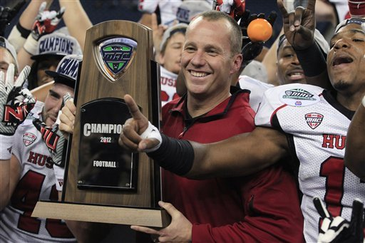 Northern Illinois coach Dave Doeren celebrates after winning the MAC championship. (AP)