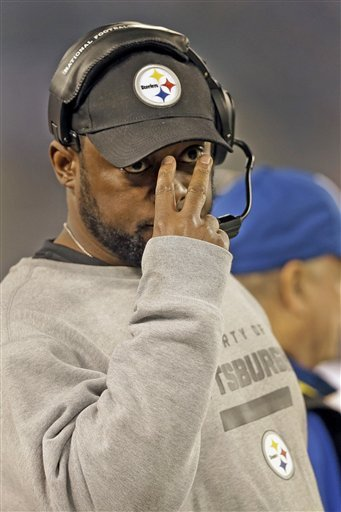 Mike Tomlin and the Steelers are still in control of a wild-card spot after Sunday's victory. (AP)