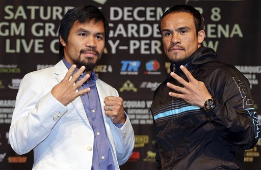 Manny Pacquiao and Juan Manuel Marquez meet for a fourth time on Saturday. (AP)