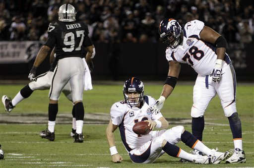 Manning leads Broncos past Raiders 26-13