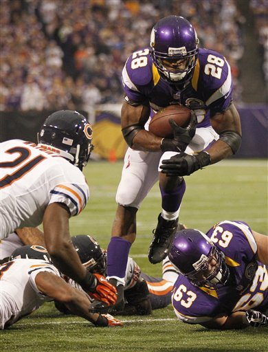 Peterson, defense lead Vikings over Bears 21-14