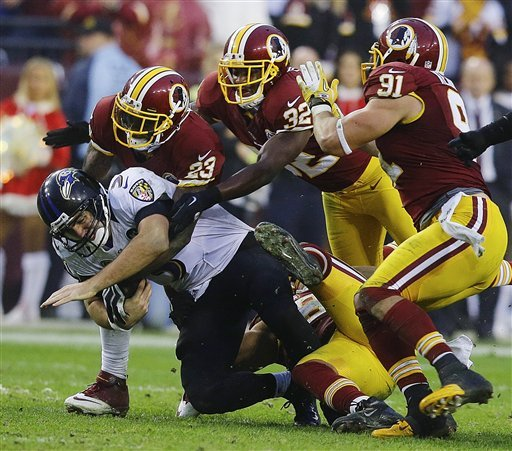 Joe Flacco was sacked twice in last Sunday's loss to the Redskins. (AP)