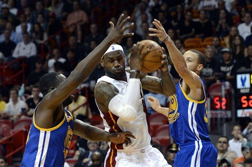 Warriors slip past Heat 97-95