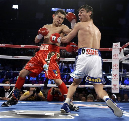 Nonito Donaire, left, hits Jorge Arce during their junior featherweight title fight. (AP)
