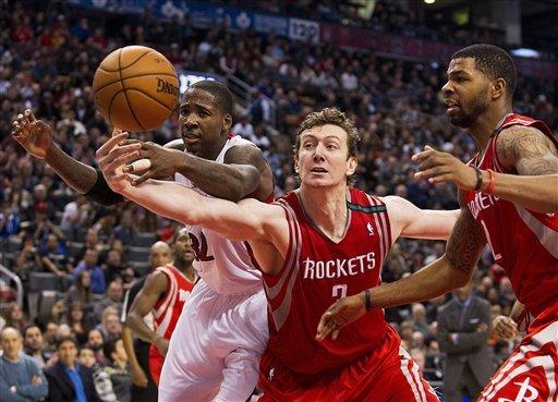 Calderon's triple-double helps Raptors top Rockets
