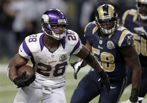 Adrian Peterson runs past Rams OLB Jo-Lonn Dunbar on his way to a 52-yard gain in the Vikes' win. (AP)