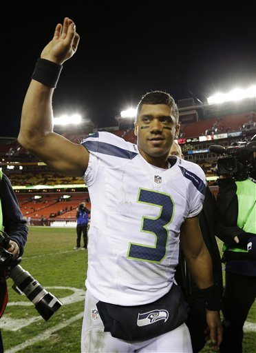 On the path to becoming the Seahawks QB, Russell Wilson was a baseball prospect for the Rockies. (AP)