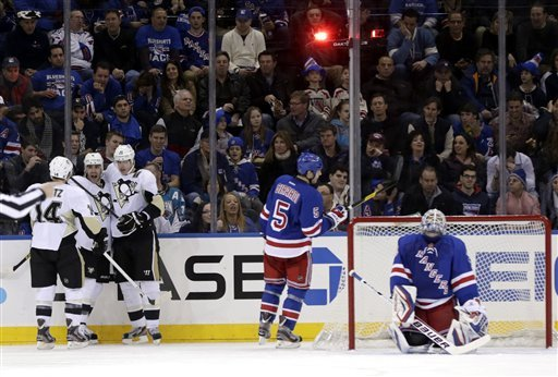 The Penguins chased Henrik Lundqvist out of the Rangers net. (AP)