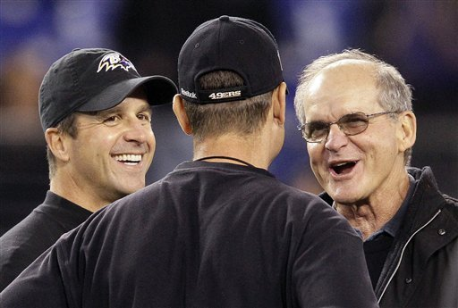 John Harbaugh, left, and his brother, Jim Harbaugh, talk with their father, Jack. (AP)