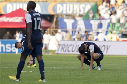 U.S. players react after a 2-1 loss to Honduras. (AP)