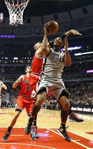 Short-handed Spurs beat Bulls 103-89