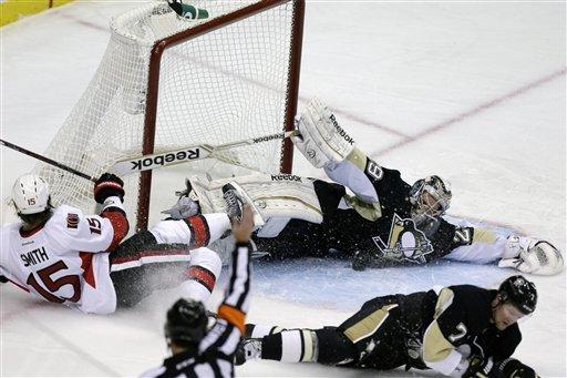 Neal scores twice, Penguins beat Senators 4-2
