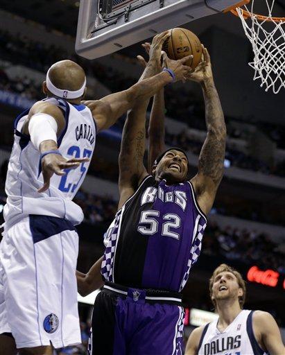 Carter passes Bird as Mavs put away Kings 123-100