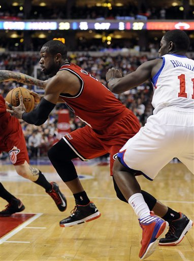 LeBron's triple-double lifts Heat over 76ers
