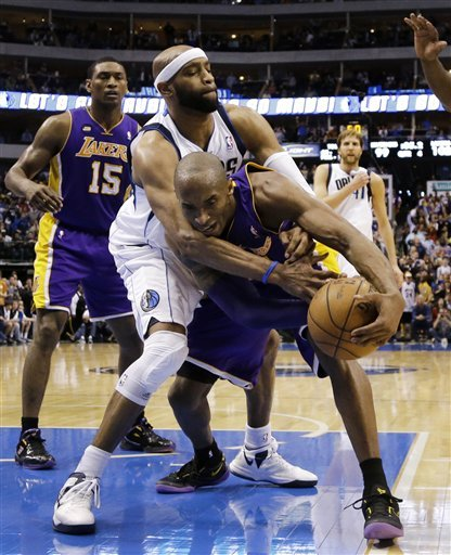 Bryant outscores Nowitzki as Lakers top Mavs