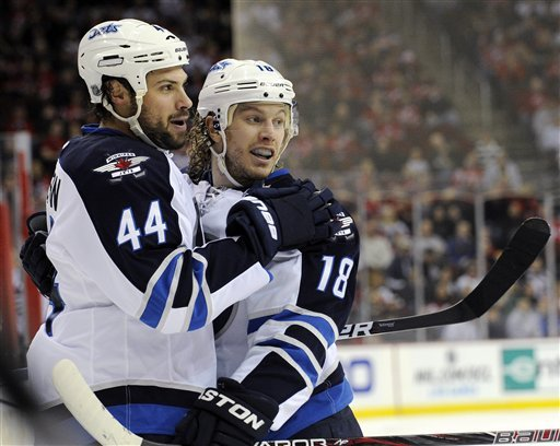 Kane, Ladd help Jets rally for 4-2 win over Devils