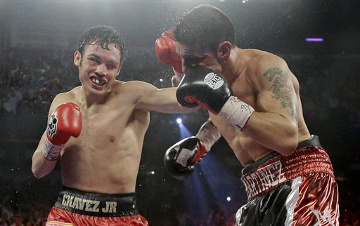 Julio Cesar Chavez Jr., left, lands a punch against Sergio Martinez during Chavez's Sept. 15 loss. (AP Photo)