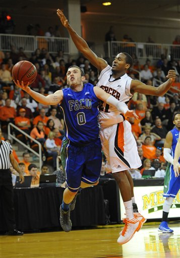 Brett Comer (0) works against Mercer's Langston Hall in the Atlantic Sun championship game. (AP)