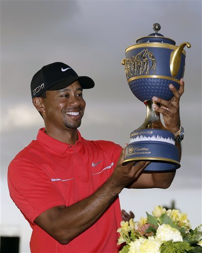 Tiger Woods holds the Gene Sarazen Cup after winning the Cadillac Championship. (AP)