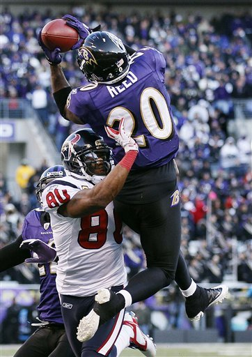 Ed Reed intercepts a pass intended for Texans WR Andre Johnson during the 2011 playoffs. (AP)