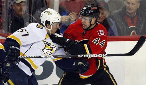 Glencross scores 3 to lead Flames past Predators