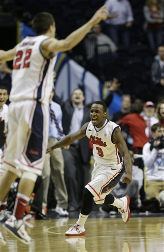 Derrick Millinghaus, right, reacts after hitting the winning shot against Missouri. (AP)