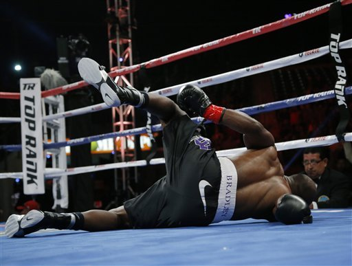 Timothy Bradley was knocked down by Ruslan Provodnikov in the first round of their fight. (AP)