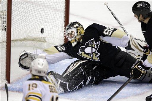 Penguins beat Bruins 2-1 to run win streak to 9