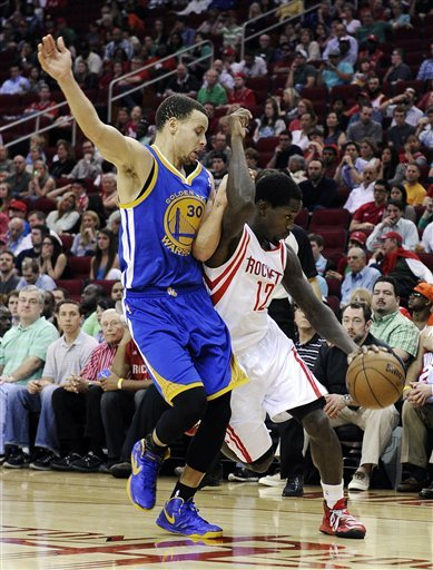 Curry, Thompson lead Warriors past Rockets