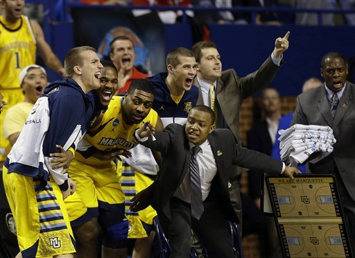 The Marquette bench reacts after a basket during its win over Butler. (AP)