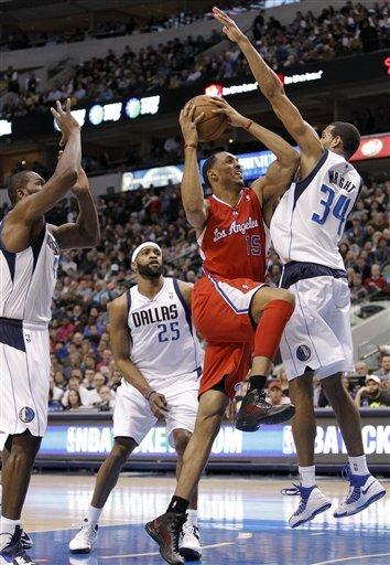 Nowitzki, Paul get 33, Mavs beat Clippers in OT