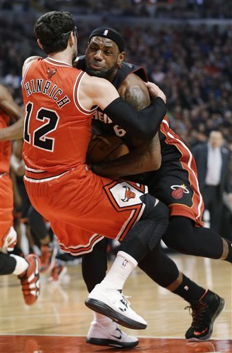 LeBron James wasn't happy with Kirk Hinrich wrapping him for a hard foul. (AP)
