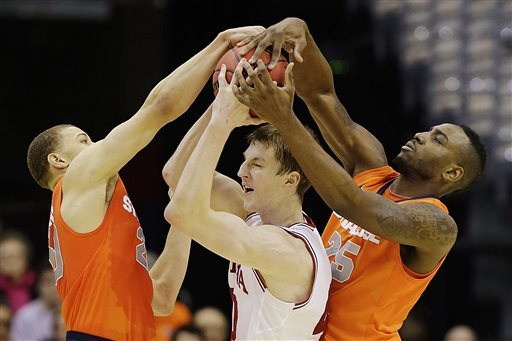 IU's Cody Zeller is trapped by Brandon Trich, left, and Rakeem Christmas. (AP)