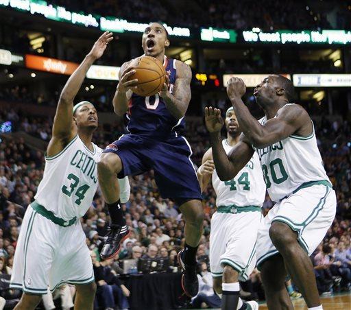 Pierce's triple-double lifts Celtics past Hawks