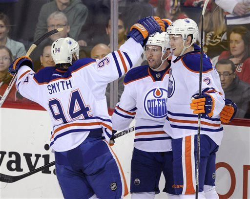 Hall leads Oilers' 8-2 rout of Flames