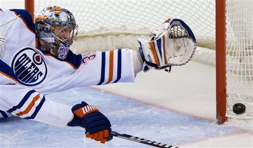 Schneider, Canucks blank Oilers, 4-0