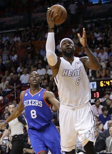 LeBron returns, Heat top 76ers 106-87