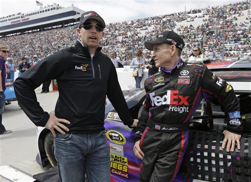 Denny Hamlin, left talks with Mark Martin before the STP 500. (AP)