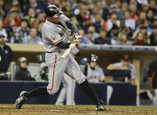 Padres edge Giants 8-7 in 12 innings on error