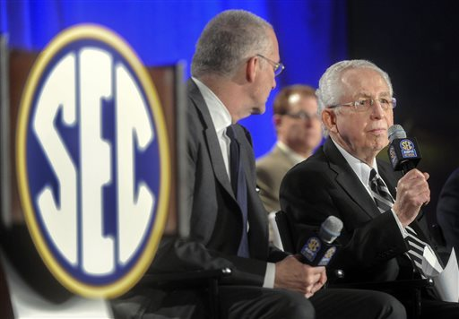Southeastern Conference Commissioner Mike Slive, right, speaks at a press conference. (AP)