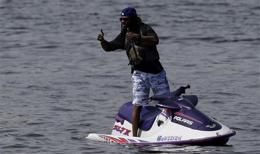 Sherman takes in Seattle minicamp from jet ski