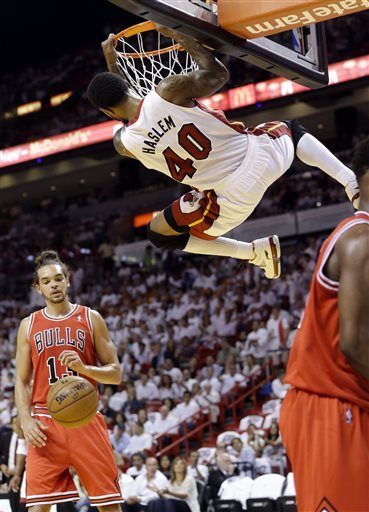 Heat rally past Bulls to advance, 94-91