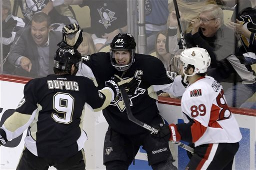 Penguins take control vs. Senators behind Crosby