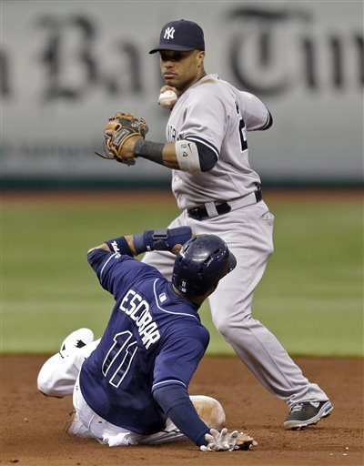 Overbay homers in 11th, Yanks beat Rays