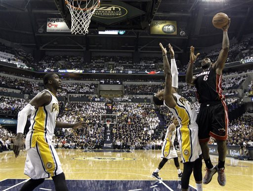 LeBron James had his way with Paul George in the post on Sunday. (AP)