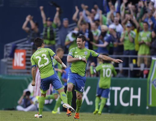 Neagle helps Sounders rally to beat Whitecaps, 3-2