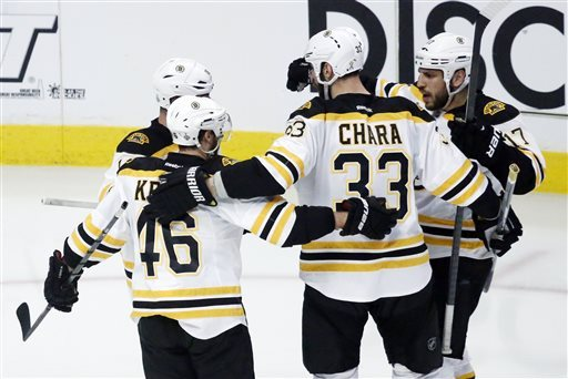 Blackhawks beat Bruins 4-3 in 3OT Cup opener