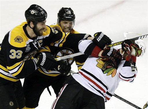 Chicago's Bryan Bickell poked Boston's biggest bear at the end of Game 3 – and paid the price. (AP)